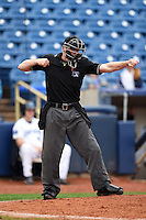 Home plate umpire Matt Winter makes a call during a game between the Dayton Dragons and Lake County Captains on June 8, 2014 at Classic Park in Eastlake, Ohio.  Lake County defeated Dayton 4-2.  (Mike Janes/Four Seam Images)