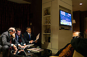 "Nov. 6, 2012 (Election Day).""While he waited for the concession call from Gov. Mitt Romney, the President worked on his acceptance speech with Jon Favreau, Director of Speechwriting, and campaign advisor David Axelrod at a Chicago hotel."" .Mandatory Credit: Pete Souza - White House via CNP"