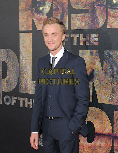 "Tom Felton.""Rise of the Planet of the Apes"" Los Angeles Premiere held at Grauman's Chinese Theatre, Hollywood, California, USA..July 28th, 2011.half length suit black white brown shoes hand in pocket                                       .CAP/RKE/DVS.©DVS/RockinExposures/Capital Pictures."