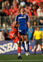 26 April 2009: Kansas City Wizards midfielder Davy Arnaud #22 heads the ball as Toronto FC defender Marvell Wynne #16 grabs on during an MLS game at BMO Field between Kansas City Wizards and Toronto FC.Toronto FC won 1-0. .
