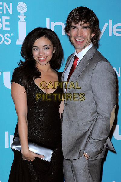 "Anel & Christopher Gorham.""A Night of Firsts"" 2012 Golden Globe Award Season Kick-off Party held at Cecconi's, West Hollywood, California, USA..December 8th, 2011  .half length  black dress silver clutch bag grey gray suit side married husband wife .CAP/ADM/TB.©Trey Barney/AdMedia/Capital Pictures."