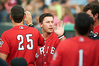 Erie SeaWolves third baseman JaCoby Jones (21) high fives teammates during a game against the Richmond Flying Squirrels on May 27, 2016 at Jerry Uht Park in Erie, Pennsylvania.  Richmond defeated Erie 7-6.  (Mike Janes/Four Seam Images)