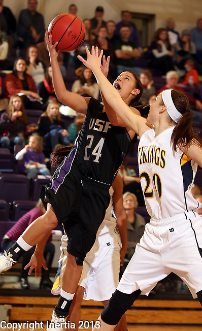 SIOUX FALLS, SD - DECEMBER 7:  Chrissy Strassburg #24 from the University of Sioux Falls lays the ball up past Rhianna Gullickson #20 from Augustana in the second half of their game Saturday evening at the Stewart Center. (Photo by Dave Eggen/Inertia)