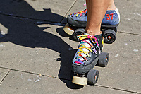 Pictured: A woman wears rainbow coloured roller skates  in the Pride parade as it travels through the streets of Swansea, Wales, UK. Saturday 05 May 2018<br /> Re: Spring Pride has brought a celebration of colour to the streets of Swansea in Wales, UK.<br /> Rainbow flags were flown in support of the LGBT community at the event, which is designed to raise awareness and is open to anyone to take part in.