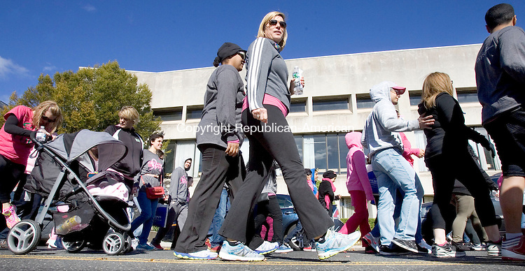 WATERBURY CT. 19 October 2014-101914SV08-Walkers make their way up Grand Street during the start of the Brass City&rsquo;s first ever Making Strides Against Breast Cancer 5K walk event in Waterbury Sunday. <br /> Steven Valenti Republican-American