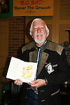 """Carroll Spinney writes the book """"The Wisdom of Big Bird & The Dark Genius of Oscar rhe Grouch"""" and personally illustrates the book as he appears at Chiller Theatre on November 1, 2009 in Parsippany, NJ. (Photo by Sue Coflin/Max Photos)"""