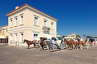 Horse drawn carriages in the city of Spetses island, Greece