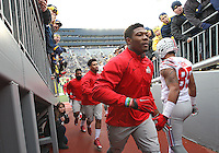 Ohio State Buckeyes linebacker Joshua Perry (37) runs up the tunnel past a crowd of Michigan  fans prior to the game at Michigan Stadium on November 28, 2015. (Chris Russell/Dispatch Photo)