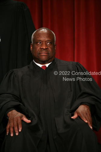 Washington, DC - September 29, 2009 -- Associate Justice of the United States Supreme Court Clarence Thomas poses for a photo during a photo-op at the U.S. Supreme Court in Washington, D.C. on Tuesday, September 29, 2009..Credit: Gary Fabiano / Pool via CNP