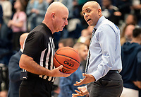 WASHINGTON, DC - NOVEMBER 16: Coach Jamion Christian of George Washington argues with an official during a game between Morgan State University and George Washington University at The Smith Center on November 16, 2019 in Washington, DC.
