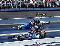 Nov. 10, 2012; Pomona, CA, USA: NHRA top fuel dragster driver Antron Brown (near lane) races alongside Cory McClenathan during qualifying for the Auto Club Finals at at Auto Club Raceway at Pomona. Mandatory Credit: Mark J. Rebilas-