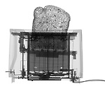 X-ray image of a toaster with bread (black on white) by Jim Wehtje, specialist in x-ray art and design images.