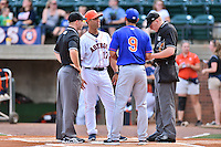 First base umpire Mark Stewart, Jr., Greenville Astros manager Josh Bonifay (17), Kingsport Mets manager Luis Rivera (9), and home plate umpire Grant Hinson before a game between the Kingsport Mets and the Greeneville Astros at Pioneer Park on July 3, 2016 in Greeneville, Tennessee. The Mets defeated the Astros 11-0. (Tony Farlow/Four Seam Images)
