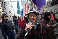 Members of radical students' union, Zengakuren at a  left-wing Rally march against the exploitation of farmers during the construction of Narita Airport. Tokyo, Japan. Sunday March 23rd 2014. The main organiser of the protest was The Farmers' League Against Narita Airport. Around 1,000 activists from this league and other unions took part.