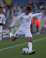 DC United forward Josh Wolff (16) crosses the ball. In a Major League Soccer (MLS) match, the New England Revolution defeated DC United, 2-1, at Gillette Stadium on March 26, 2011.