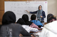 Pictured: The english language teacher by the board Monday 06 February 2017<br /> Re: A school teaching the English language has been operating at the migrant camp located in the former airport in the outskirts of Athens, Greece.