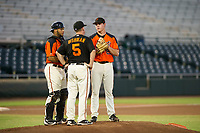 AZL Giants starting pitcher Seth Corry (63) is visited by catcher Jeffry Parra (5) and pitching coach Glenn Dishman (5) AZL Rangers on August 22 at Scottsdale Stadium in Scottsdale, Arizona. AZL Rangers defeated the AZL Giants 7-5. (Zachary Lucy/Four Seam Images via AP Images)