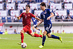 Haraguchi Genki of Japan (R) fights for the ball with Do Duy Manh of Vietnam (L) during the AFC Asian Cup UAE 2019 Quarter Finals match between Vietnam (VIE) and Japan (JPN) at Al Maktoum Stadium on 24 January 2019 in Dubai, United Arab Emirates. Photo by Marcio Rodrigo Machado / Power Sport Images