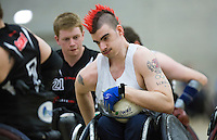 27 MAY 2013 - DONCASTER, GBR - David Anthony of the South Wales Pirates looks for a way through the West Coast Crash defence during the 2013 Great Britain Wheelchair Rugby Nationals bronze medal match at The Dome in Doncaster, South Yorkshire .(PHOTO (C) 2013 NIGEL FARROW)