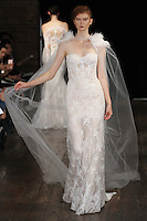 """Model walks runway in a """"Desire"""" bridal gown from the Alyne by Rita Vinieris Fall 2017 collection on October 7th, 2016 during New York Bridal Fashion Week."""