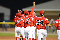 Batavia Muckdogs pitcher Miguel Del Pozo #47, Robert Ravago #34 and teammates run onto the field after Connor Burke (hidden) walk off hit during a game against the Mahoning Valley Scrappers on June 22, 2013 at Dwyer Stadium in Batavia, New York.  Batavia defeated Mahoning Valley 2-1 in ten innings.  (Mike Janes/Four Seam Images)