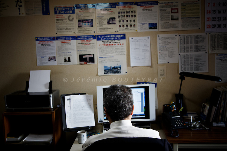 Tokyo, October 25 2012 - At the office of NARKN, National Association for the Rescue of Japanese Kidnapped by North Korea. Secretary general Ryutaro HIRATA pictured in his office.