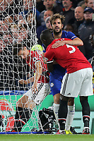Eric Bailly of Manchester United helps Chelsea's Cesc Fabregas to his feet after he fell into the side netting of the goal during Chelsea vs Manchester United, Premier League Football at Stamford Bridge on 5th November 2017
