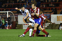 Pat Hoban of Grimsby Town has a shot blocked during the Vanarama National League match between Aldershot Town and Grimsby Town at the EBB Stadium, Aldershot, England on 5 April 2016. Photo by Paul Paxford / PRiME Media Images.