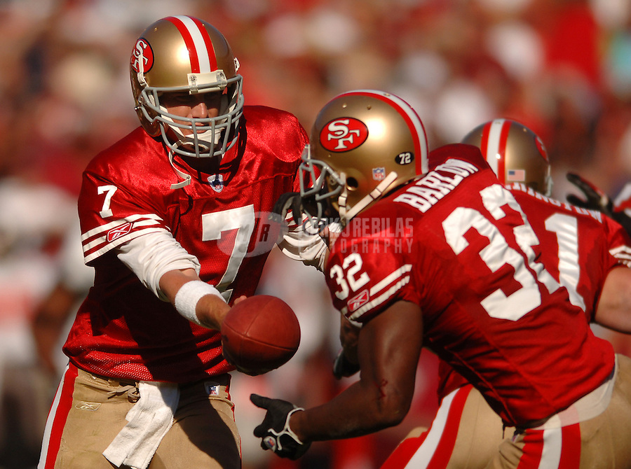 Oct 30, 2005; San Francisco, CA, USA;  San Francisco 49ers quarterback #7 Ken Dorsey hands off the ball to running back #32 Kevan Barlow against the Tampa Bay Buccaneers in the second quarter at Monster Park. Mandatory Credit: Photo By Mark J. Rebilas