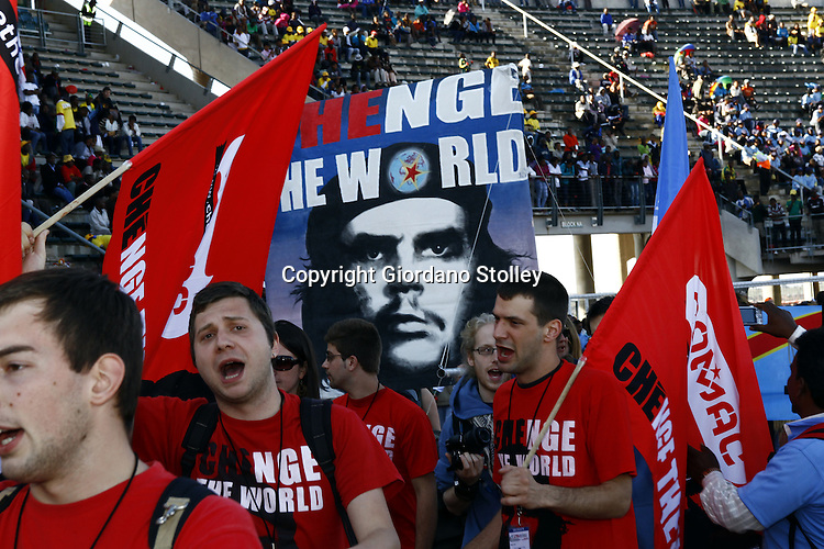 PRETORIA - 13 December 2010 - The Belgian delegation to the 17th World Festival of Youth and Students carry a banner of Che Guevara as they march through the Lucas Moribe stadium at the start of the festival. -- APP/Allied Picture Press