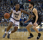 Nevada forward Jordan Caroline (24) drives past San Diego State guard Jordan Schakel (20) in the second half of an NCAA college basketball game in Reno, Nev., Saturday, March 9, 2019. (AP Photo/Tom R. Smedes)