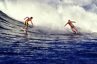 Unique shot of a father and son riding a big wave at Hapuna Beach on the Big Island of Hawaii.
