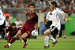 08 July 2006: Cristiano Ronaldo (POR) (17) watches Torsten Frings (GER) (8) try to make a play on the ball. Germany defeated Portugal 3-1 at the Gottlieb-Daimler Stadion in Stuttgart, Germany in match 63, the third-place game, of the 2006 FIFA World Cup.