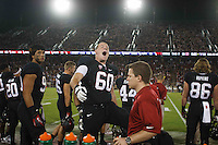 STANFORD,CA-- October 5, 2013: Brian Moran asks the crowd to cheer during the Stanford vs Washington game Saturday night at Stanford Stadium.<br /> <br /> Stanford won 31-28.