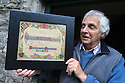 29/05/14 <br /> <br /> <br /> Owner of the garden where Coffin Well is, Les Alcock shows off his uncle's certificate that was given to him when he returned to Tissington after fighting in the First World War.<br /> <br /> Well-Dressing boards are blessed following church service.<br /> <br /> Wooden boards coated in clay are decorated with tens of thousands of petals, leaves and pieces of foliage to create giant intricate mosaics. The boards, that each take teams of ten villages three days to make are part of the Well Dressing displays in Tissington, Derbyshire. <br /> <br /> The village has been decorating its six wells every year for more than six hundred years. The tradition is believed to be a celebration of the wells never running dry, giving life and  sustaining the village during times of plague. After a church service today (Thursday)  clergy from six parish will bless each of the well.  <br /> <br /> Following in Tissington's footsteps many other villages in the Derbyshire area also have their own well dressing traditions.<br /> <br /> All Rights Reserved - F Stop Press.  www.fstoppress.com. Tel: +44 (0)1335 300098