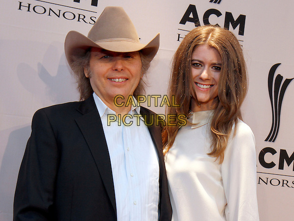 Dwight Yoakam and Emily Joyce.The Academy of Country Music honored artists and music industry professionals at their annual Honors Awards held at the world-famous Ryman Auditorium in downtown Nashville, TN., USA..September 24th, 2012.half length black jacket blue shirt white dress couple beige stetson hat.CAP/ADM/DH.©Dan Harr/AdMedia/Capital Pictures.