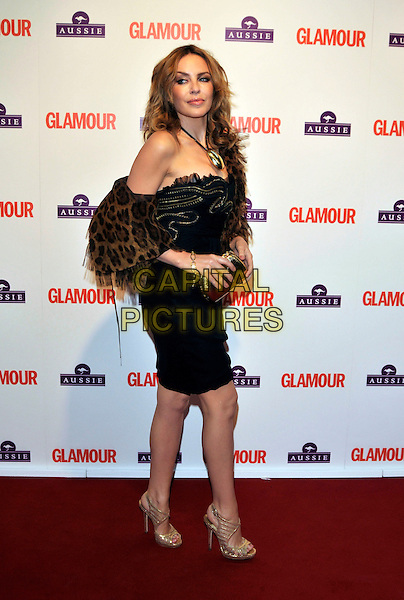 KYLIE MINOGUE .Glamour Women of The Year Awards 2009, Berkeley Square Gardens, London, England, June 2nd 2009..full length black dress leopard print wrap shawl gold necklace sandals clutch bag open toe strapless  .CAP/PL.©Phil Loftus/Capital Pictures