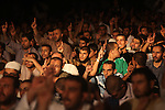 """Palestinians chant slogans following a night prayer known as """"Tarawih"""" leads by Palestinian Prime Minister in Gaza Ismail Haniyeh at a sit-in tent in Gaza city, solidarity with Egyptian soldiers who were killed on Rafah border between Egypt and the southern Gaza Strip, on 06 August 2012.  Media reports state that 16 Egyptian security forces were killed and seven others injured on 05 August when militants opened fire on a checkpoint and commandeered vehicles during a Ramadan fast in Rafah. Having hijacked the vehicles, they raced to the nearby Kerem Shalom/Karm Abu Salem crossing point on the Egypt-Israel-Gaza border. Egyptian authorities closed the border crossing with the Gaza Strip at Rafah indefinitely. Photo by Majdi Fathi"""
