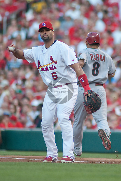 08 July 2011            St. Louis Cardinals first baseman Albert Pujols (5) makes the out on Arizona Diamondbacks left fielder Gerardo Parra (8) and prepares to throw the ball around the horn. The St. Louis Cardinals hosted the Arizona Diamondbacks in the second game of a four game series on Friday July 8, 2011 at Busch Stadium in downtown St. Louis.