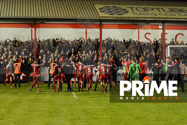 Stourbridge players celebrate with their fans following their 3-0 victory during the FA Cup 1st round replay match between Stourbridge and Whitehawk  at the War Memorial Athletic Ground, Stourbridge, England on 14 November 2016. Photo by Garry Griffiths.