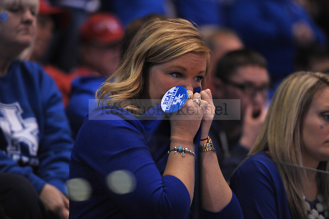 A UK fan anxiously covers their face while waiting for the referees to determine possession of the ball during the last few seconds of the game during the NCAA Sweet 16 vs. UofL at the Lucas Oil Stadium in Indianapolis , Ind., on Saturday, March 29, 2014. Photo by Eleanor Hasken | Staff