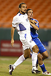30 October 2004: Dwayne De Rosario (left) and Nick Garcia (right) in the first half. The Kansas City Wizards defeated the San Jose Earthquakes 3-0 at Arrowhead Stadium in Kansas City, MO in the second leg of their Major League Soccer Western Conference Semifinal playoff series. The Wizards eliminated the Earthquakes 3-2 on aggregate goals..