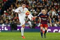Real Madrid´s James Rodriguez (L) and Barcelona´s Andres Iniesta during 2015-16 La Liga match between Real Madrid and Barcelona at Santiago Bernabeu stadium in Madrid, Spain. November 21, 2015. (ALTERPHOTOS/Victor Blanco) /NortePhoto