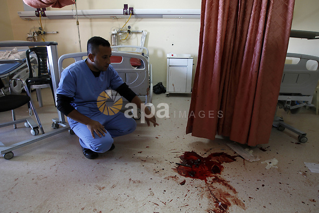 A Palestinian Staff checks the room where Israeli special forces killed 27 years old Abdallah Shalaldeh at the Al-Ahli hospital in the West Bank city of Hebron 12 November 2015. Abdallah Shalaldeh was shot dead by Israeli special forces during a raid to arrest his cousin Azzam Shalaldeh. An undercover Israeli unit raided a southern West Bank hospital early 12 November, killing one Palestinian and seizing another, the Palestinian Health Ministry said. An Israeli military spokeswoman in Tel Aviv said that security forces had sought to apprehend a Palestinian accused of stabbing an Israeli outside a settlement bloc south of Jerusalem on 25 October 2015. The alleged Palestinian assailant, Azzam Shalaldeh, 20, had been shot by the Israeli victim. The Israeli was, in turn, severely injured with a stab wound to the chest. Photo by Wisam Hashlamoun