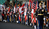 Honor guards carry US and Canadian flags at the White House as part of the official Arrival Ceremony opening the Official Visit of Prime Minister Justin Trudeau and Mrs. Sophie Gr&eacute;goire Trudeau of Canada on the South Lawn of the White House in Washington, DC on Thursday, March 10, 2016. <br /> Credit: Olivier Douliery / Pool via CNP