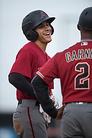 AZL Diamondbacks left fielder Alek Thomas (5) jokes with manager Darrin Garner (2) after hitting a triple during the completion of a suspended Arizona League game against the AZL Angels at Tempe Diablo Stadium on July 16, 2018 in Tempe, Arizona. The game was a continuation of the July 11, 2018 contest that was suspended by rain in the middle of the eighth inning. The AZL Diamondbacks defeated the AZL Angels 12-8. (Zachary Lucy/Four Seam Images)