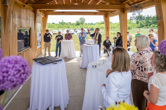 June 10, 2016; Director of Campus Ministry Rev. Pete McCormick, C.S.C. says a prayer of blessing at the dedication of the Morrison Pavilion at the ND LEEF facility in St. Patrick's County Park. (Photo by Matt Cashore/University of Notre Dame)