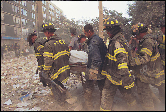 Attack on the World Trade Center, firemen remove a body from the wreckage, Battery Park City, New York City, New York, USA, September 11, 2001