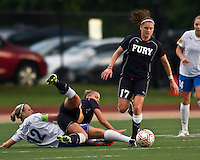 New York Fury midfielder Sinead Farrelly (17) recovers the ball after  Boston Breakers midfielder Leslie Osborne (12) and New York Fury forward Merritt Mathias (9) collide in a tackle.  The Boston Breakers beat the New York Fury 2-0 at Dilboy Stadium