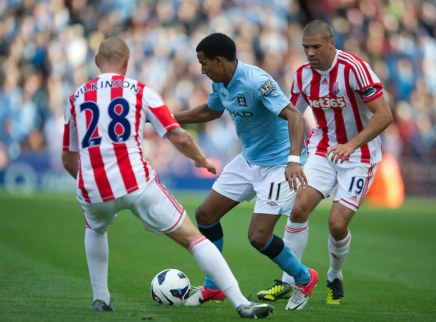 Manchester City's Scott Sinclair battles with Stoke City's Andy Wilkinson (L) and Stoke City's Jonathan Walters ..Football - Barclays Premiership - Stoke City v Manchester City - Saturday 15th September 2012 - Britannia Stadium - Stoke..